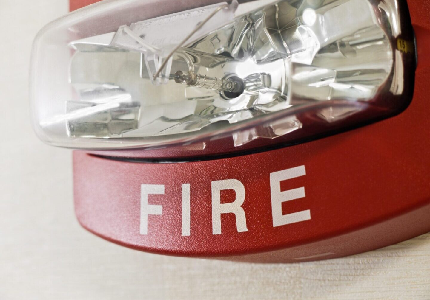 Red fire alarm with strobe light